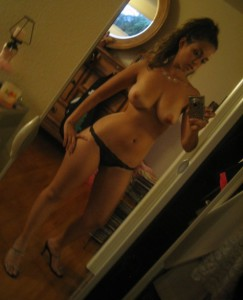 nude college girl taking selfie
