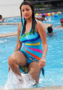beautiful indian young girl swiming dress