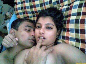 Desi Couple horny in bed pic